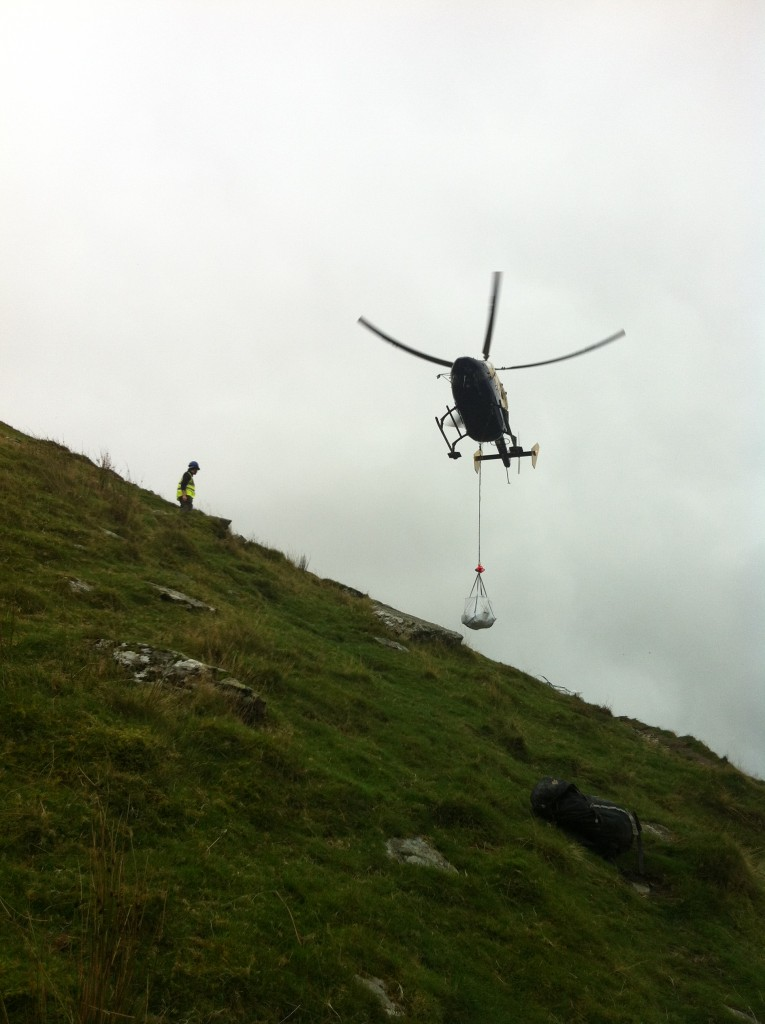 A helicopter lifting stone for essential footpath work on the Snowdon Ranger  path